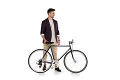 Full length view of handsome stylish young man standing with bicycle Royalty Free Stock Image