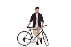 Full length view of handsome stylish young man standing with bicycle Royalty Free Stock Photography