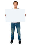 Full length view of man showing blank signboard Royalty Free Stock Photo