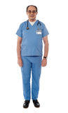 Full length view of senior doctor. Posing in front of camera Stock Images