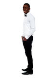 Full length view of smart young man. Side pose Stock Photo