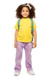Full length view of smiling African girl with bag stock image