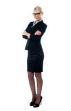 Full length view welldessed corporate woman. Full view welldessed corporate woman posing confidently in front of camera Royalty Free Stock Photo