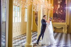 Full length of wedding couple dancing in church Royalty Free Stock Photography