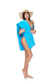 Full length woman in blue bikini with beach towel Royalty Free Stock Photography
