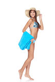 Full length woman in blue bikini with beach towel Royalty Free Stock Image