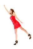 Full length woman in elegant red dress holding imaginary balloons and flying Royalty Free Stock Photo