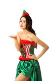 Full length woman elf clothes blowing a kiss Stock Image