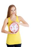Full length woman holding big clock Royalty Free Stock Photos