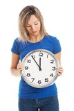 Full length woman holding big clock Stock Photography