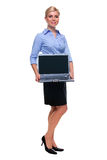 Full length woman holding laptop computer with bla Stock Images