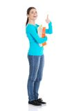 Full length woman holding notes showing thumbs up Stock Image