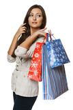 Full length of woman holding shopping bags and pointing to the side Stock Photos