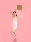 Full length Woman holding showing sign, Sexy beautiful girl hold. Ing brown blank sign board with copyspace,Asian  female model on pink background Stock Images