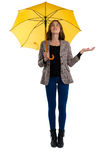 Full length of woman holding umbrella while gesturing. Against white background Royalty Free Stock Photography