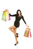 Full length woman with a lot of shopping bags Stock Photo