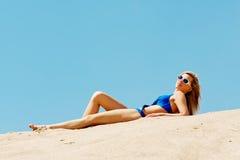 Full length woman lying on the beach Royalty Free Stock Photos