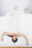 Full length of a woman lying in bed Stock Images