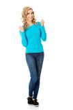 Full length woman making winner gesture Royalty Free Stock Photography