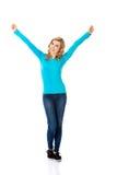 Full length woman making winner gesture.  Royalty Free Stock Photo