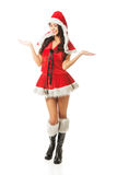 Full length woman with open hands gesture wearing santa clothes Stock Photos