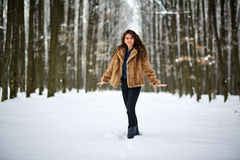 Full length of a woman outdoor in the snow Stock Photos