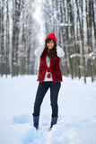 Full length of a woman outdoor in the snow. Full length of an attractive young woman in snow outdoor Royalty Free Stock Photo