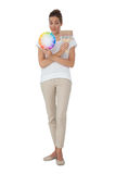 Full length of a woman with paint samples and paintbrush Royalty Free Stock Photo