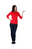 Full length woman pointing to the right Royalty Free Stock Photo