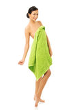 Full length woman standing wrapped in towel Stock Image