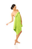 Full length woman standing wrapped in towel Royalty Free Stock Photography