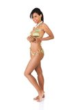 Full length woman in swimwear holding coconut Stock Photos