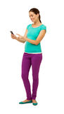 Full Length Of Woman Touching Smart Phone Stock Photos