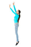 Full length woman trying to reach high Royalty Free Stock Images