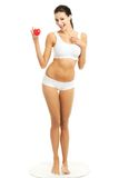 Full length woman in underwear holding heart model.  Royalty Free Stock Image
