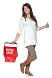 Full length woman walking with red shopping basket Stock Photography