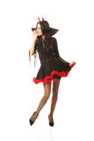 Full length woman wearing devil clothes whispering to someone Stock Photography