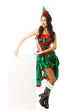 Full length woman wearing elf clothes holding white banner on the floor Stock Images