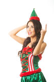 Full length woman wearing elf clothes pointing up Royalty Free Stock Photos
