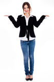 Full length of women posing with her hands open up Royalty Free Stock Photography