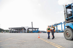 Full-length of workers walking in shipping yard Royalty Free Stock Image