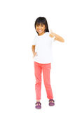 Full length of young asian girl showing thumbs up Royalty Free Stock Photo