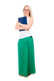 Full length of young blond girl holding clipboard Royalty Free Stock Photography
