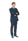 Full length of young business man. Standing with arms folded isolated on white background stock image
