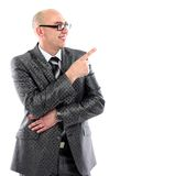 Full length of young business man in suit pointing at copy space Stock Photos