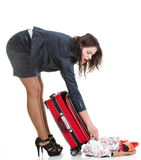 Full length young business woman to late red travel bag Stock Photo
