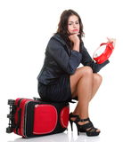 Full length young business woman to late red travel bagd Royalty Free Stock Photo