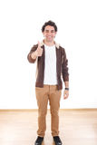 Full length young casual man showing thumbs up royalty free stock photo
