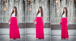 Full length of young Caucasian female with long red skirt standing near fountain Royalty Free Stock Photos