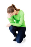 Full length young depressed woman crouching Stock Images